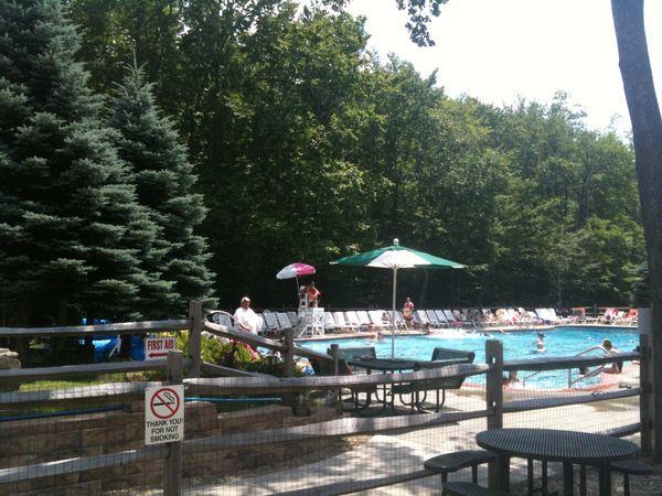 the swimming pool at big bass lake poconos real estate blog
